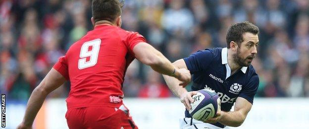 Greig Laidlaw takes on Rhys Webb