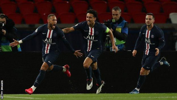 Neymar celebrates scoring in a 2-0 win over Borussia Dortmund in a behind-closed-doors game at the Parc de Princes