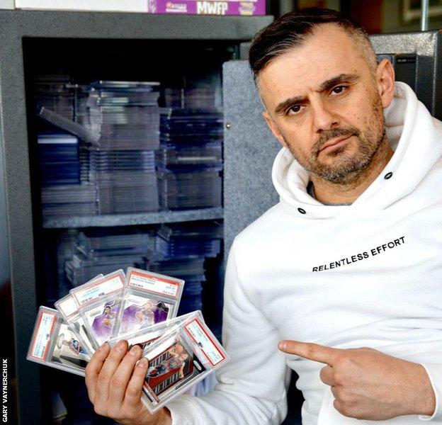 Gary Vaynerchuk holds a collection of sports cards