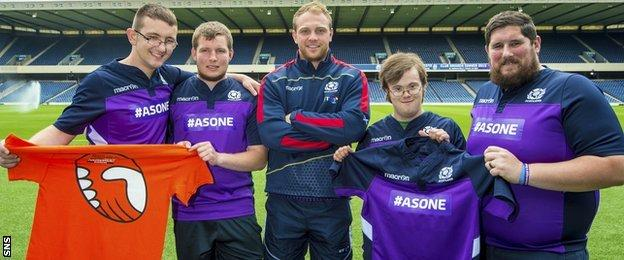 Greig Tonks and members of Scotland's unified rugby team at Murrayfield Stadium