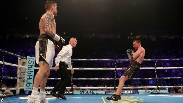 Scott Cardle falls to the floor as he is knocked down by Ricky Burns