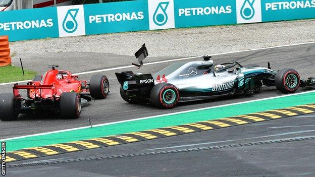Lewis Hamilton and Sebastian Vettel make contact on the first lap of the Italian GP in Monza