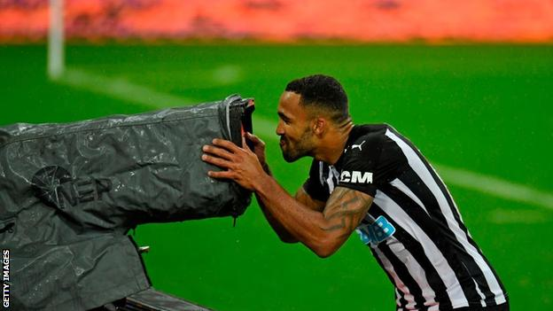 Callum Wilson goes to kiss a TV camera