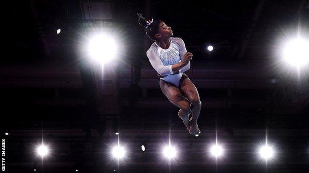 Simone Biles competes on the floor during the women's all-around final in Stuttgart