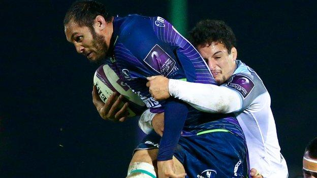Connacht's George Naoupu is tackled by Newcastle's Tom Penny in Galway