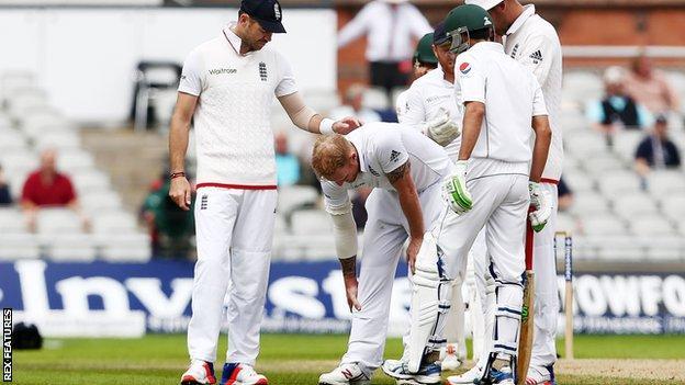 Ben Stokes clutches his right leg