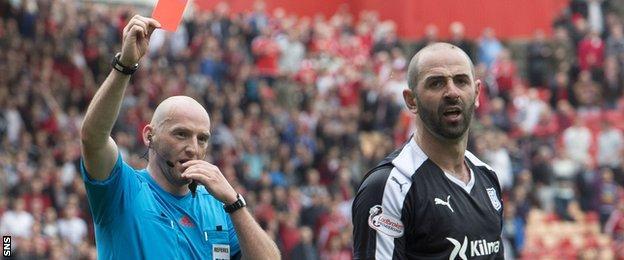 Dundee's Gary Harkins was sent off late on for fouling Adam Rooney in the box
