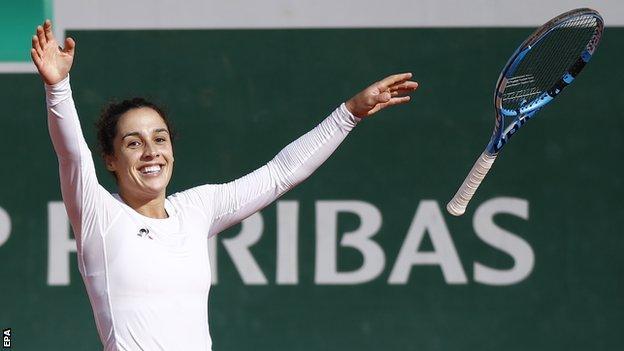 Martina Trevisan celebrates beating Kiki Bertens