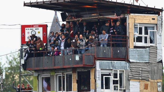 St Pauli fans celebrate taking the lead over Dortmund in a 2010 Bundesliga game from a makeshift stand