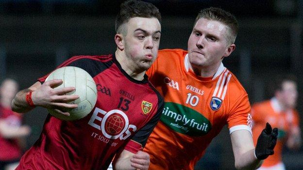 Down forward Tiarnan Rushe comes under pressure from Armagh's Paul Quinn at the Athletic Grounds
