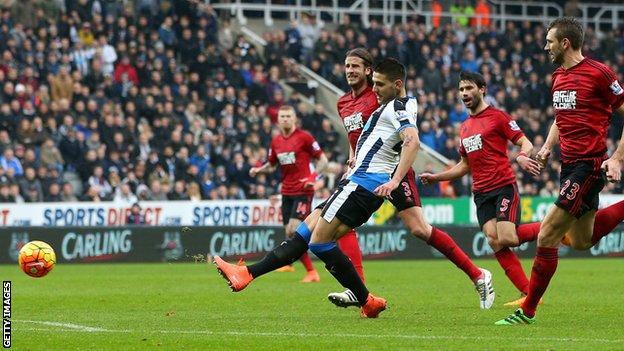 Newcastle's Aleksandar Mitrovic scores