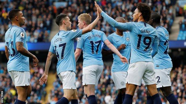 Manchester City players celebrate against Burnley