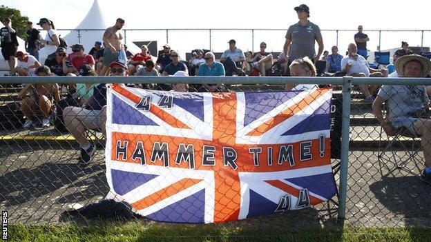 Fans hang a Lewis Hamilton flag