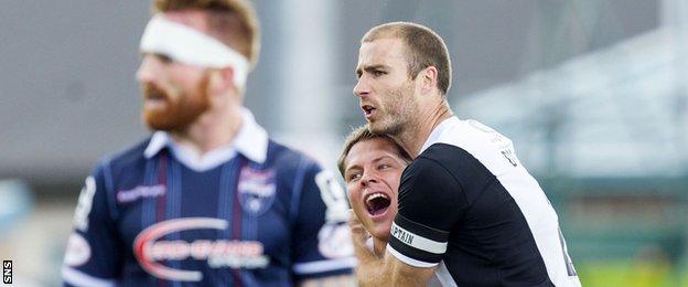 Dundee United midfielder John Rankin celebrates Sean Dillon's 30-yard goal