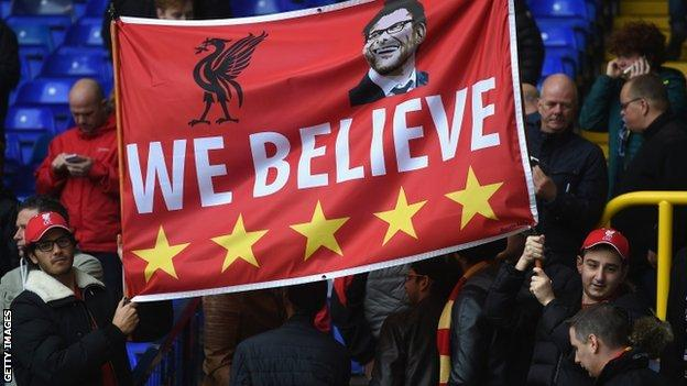 Liverpool fans with a Jurgen Klopp banner at White Hart Lane