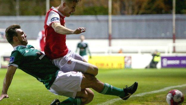 Derry's Gavin Peers slides in to challenge Jake Keegan at Richmond Park