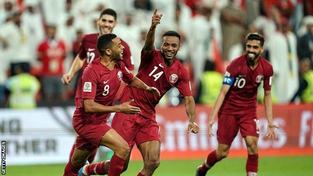 Qatar players celebrate a goal