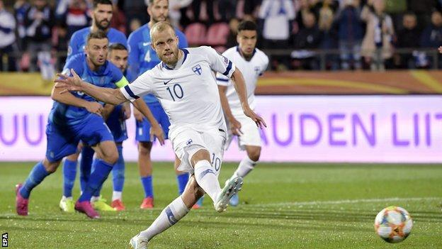 Teemu Pukki scores a penalty against Greece
