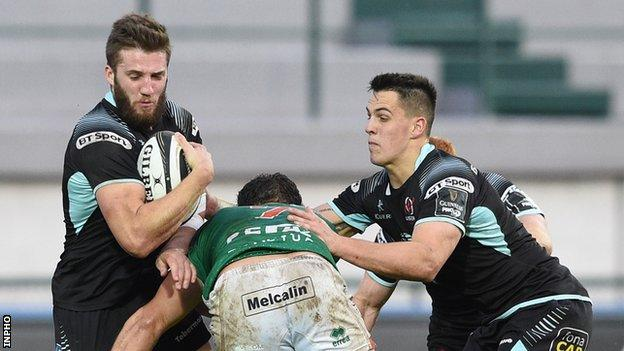 Ulster's Stuart McCloskey and James Hume are tackled by Benetton's Michele Lamaro
