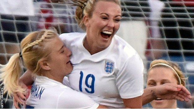 Toni Duggan celebrates scoring England's opening goal against Germany