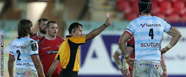 Referee Greg Garner shows a red card to Racing's Bernard Le Roux