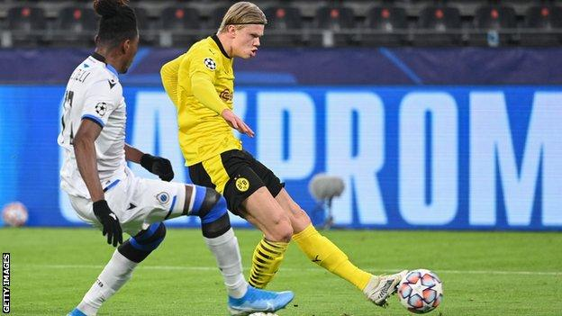 Erling Braut Haaland scores Borussia Dortmund's first goal against Club Bruges in the Champions League