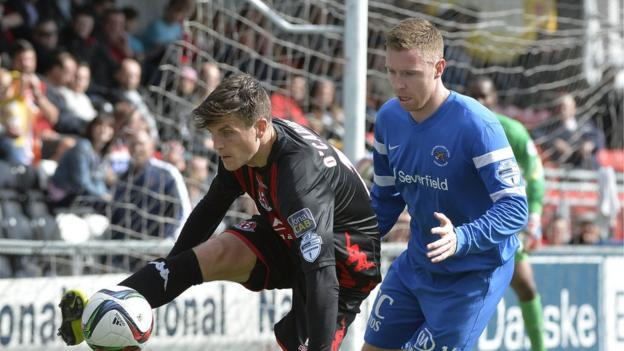 Crusaders goalscorer Diarmuid O'Carroll shields the ball from Chris Crilly