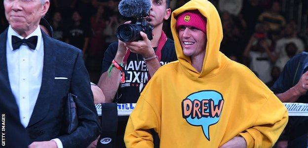 Justin Bieber stands in the ring