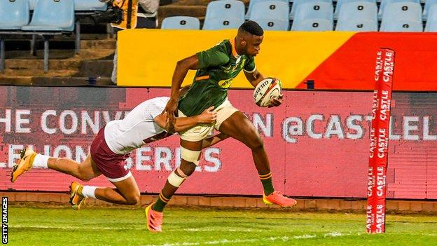 South Africa wing Aphelele Fassi runs over the tryline to score