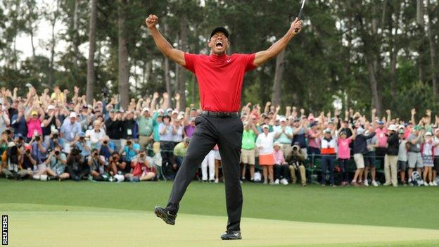 Tiger Woods celebrates on the 18th hole after winning the 2019 Masters