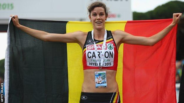 Belgium's Louise Carton celebrates after her European Under-23 Cross Country triumph in Hyeres on Sunday