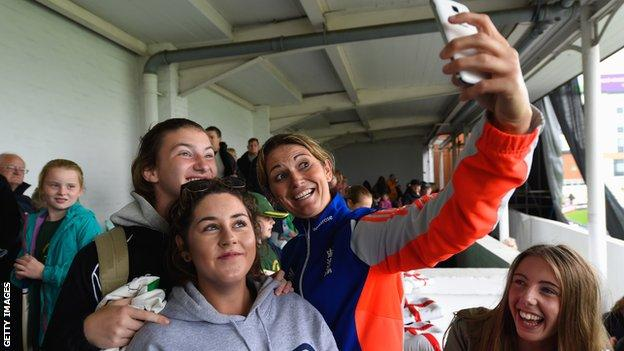 """England captain Charlotte Edwards takes a """"selfie"""" picture with fans"""