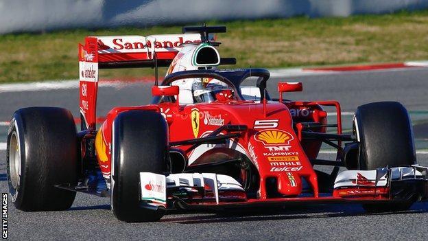 Sebastian Vettel of Ferrari tests the Halo device