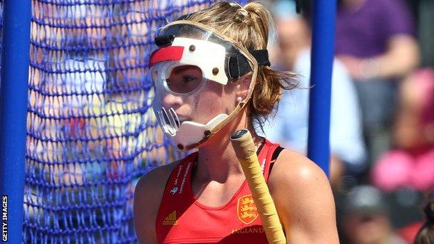 Shona McCallin wearing hockey mask