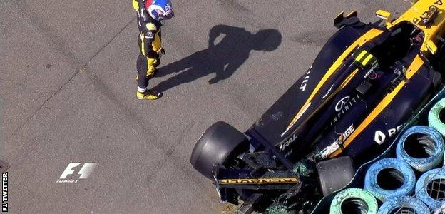 Jolyon Palmer surveys the damage to his car after losing the rear at the final corner