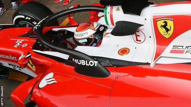 Ferrari's Kimi Raikkonen tests the new halo head protection system