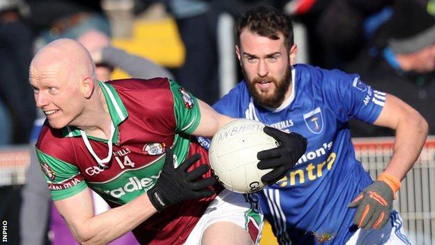 Coleraine's Colm McGoldrick attempts to get away from Scotstown's Emmet Caulfield at Omagh