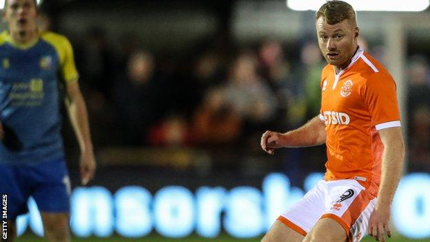 Chris Taylor in action for Blackpool