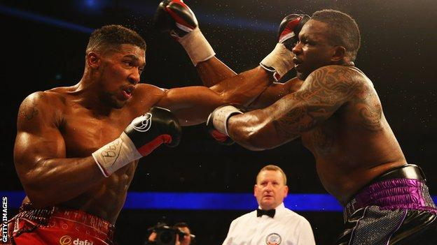 Anthony Joshua lands a right hand on Dillian Whyte