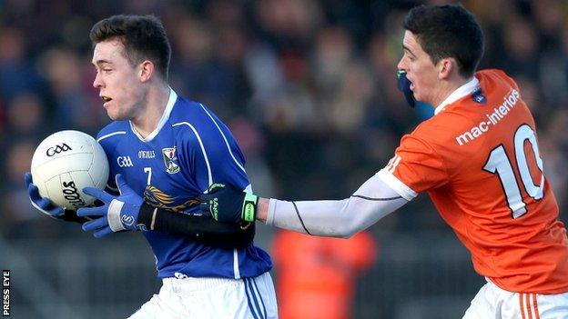 Cavan's Dara McVeety tries to burst away from Armagh's Rory Grugan at Crossmaglen