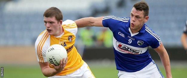 Antrim's Owen Gallagher attempts to get away from John O'Loughlin