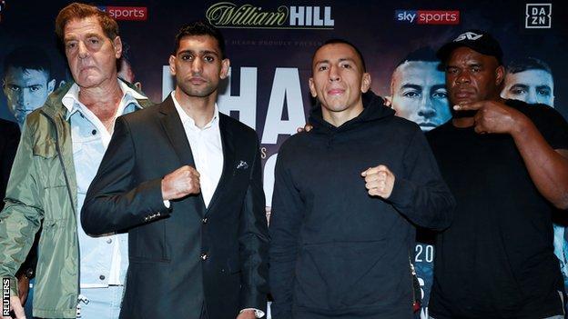 Khan will be fighting under trainer Joe Goossen (left) for the second time