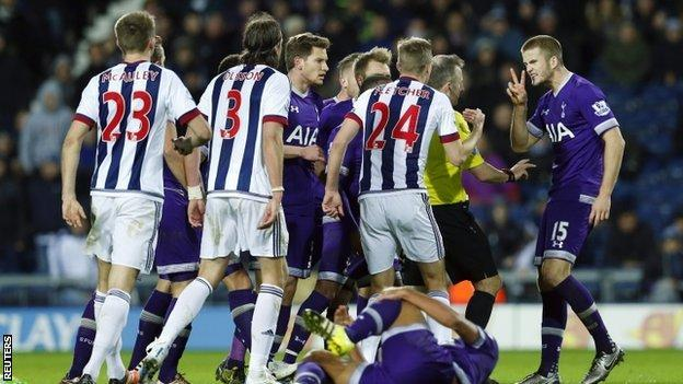West Brom and Spurs players surround the referee