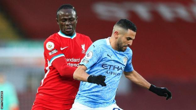 Liverpool and Senegal's Sadio Mane (left) up against Manchester City and Algeria's Riyad Mahrez