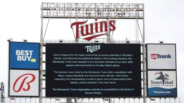 A sign at Minnesota Twins' Target Field stadium with a statement explaining the MLB side's decision to postpone their game against the Boston Red Sox