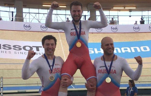 Shane Perkins (left) with Pavel Yakushevskiy and Denis Dmitriev after winning team sprint gold at the World Cup in Chile in December