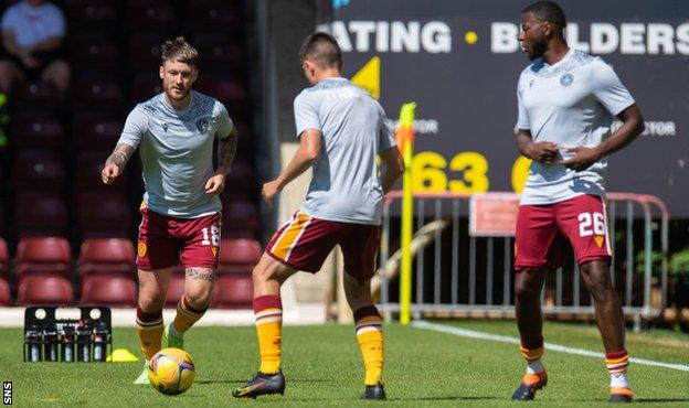 Callum Slattery warms up for Motherwell