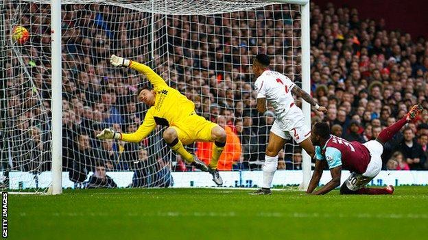Michail Antonio heads West Ham United ahead against Liverpool