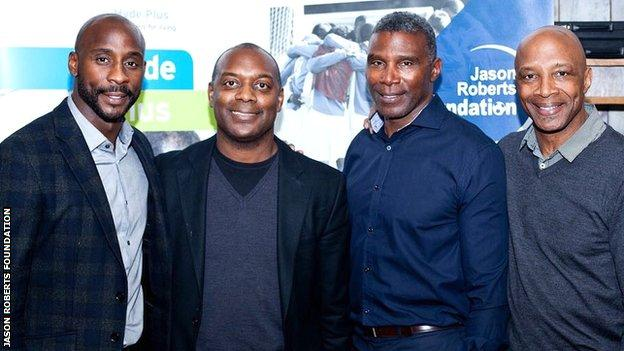 Jason Roberts with his three uncles, including Cyrille, last week
