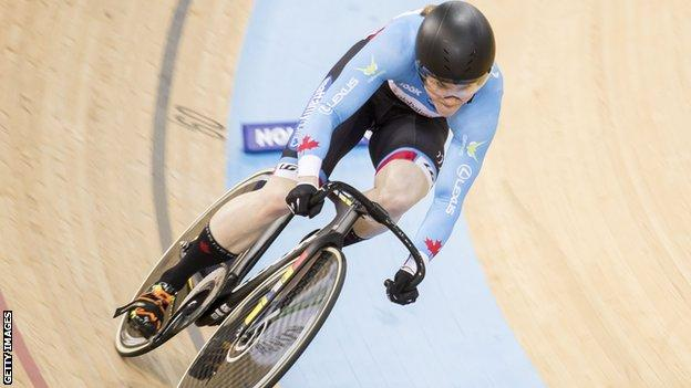 Kate O'Brien cycling in a velodrome